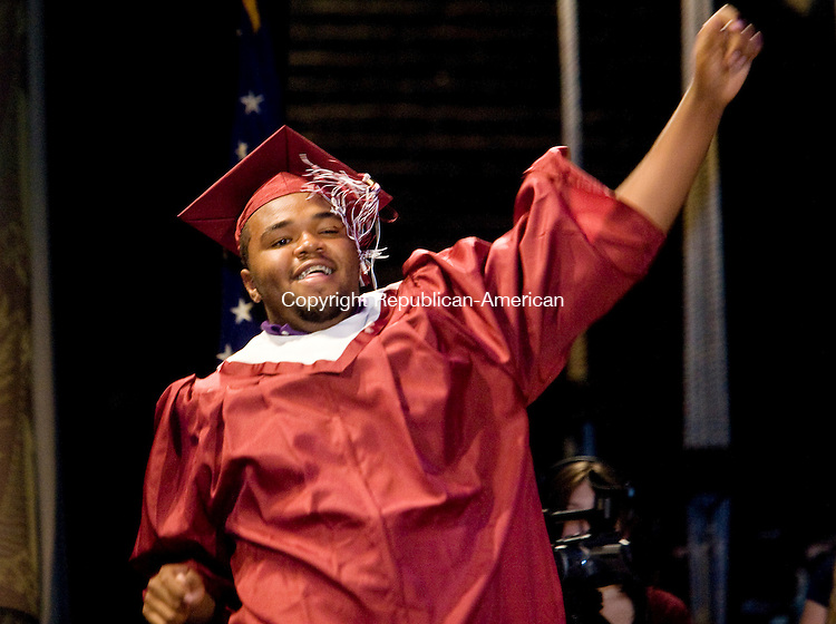 TORRINGTON--15 June 08--061508TJ09 - Jaquil Smith dances on to the Warner Theatre stage to receive his diploma during Torrington High School's graduation on Sunday, June 15, 2008. (T.J. Kirkpatrick/Republican-American)