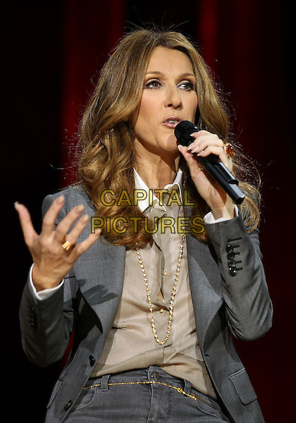 CELINE DION.Celine Dion's Momentous Return To The Colosseum Press Conference At Caesars Palace Resort Casino, Las Vegas, Nevada, USA..March 15th, 2011.half length grey gray jacket gold hand necklace beige shirt blouse microphone .CAP/ADM/MJT.© MJT/AdMedia/Capital Pictures.