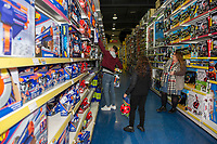Pictured: buying children gifts at Smyth's Toy Store, in Swansea, Wales, UK. Wednesday 19 December 2018