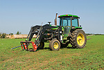 1980s John Deere 4240 tractor with hay spikes for hay rolls
