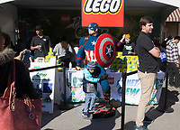 NWA Democrat-Gazette/CHARLIE KAIJO Sajith Bhaskar, 5, of Bentonville (center) plays on a Captain America Lego statue, Friday, November 1, 2019 during the First Friday Toyland at the downtown square in Bentonville.<br /> <br /> The theme of this month's First Friday block party is Toyland. Kids had the opportunity to try out the latest toys.