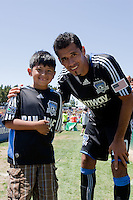 Ramon Sanchez smiles with a young fan. The San Jose Earthquakes defeated Seattle Sounders FC 4-0 at Buck Shaw Stadium in Santa Clara, California on August 2, 2009.