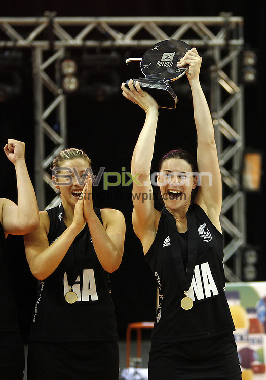 PICTURE BY VAUGHN RIDLEY/SWPIX.COM - Netball - World Netball Series 2010 - England v New Zealand Final - Echo Arena, Liverpool, England - 21/11/10...Copyright - Simon Wilkinson - 07811267706...New Zealand Captain Maree Bowden lifts the Championship Trophy.