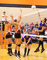 Photo by Randy Moll<br /> Stephanie and Amanda Pinter, Gravette junior and senior, jump to block a kill attempt by Ally Teague, Berryville senior,  during play at Gravette High School on Thursday, Sept. 10, 2015.