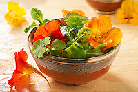 Fresh nasturtium flowers & leaves in a salad