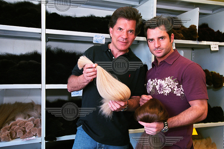 Great Lengths founder David Gold and his son show off their products, made from imported Indian hair. The hair is bleached and dyed in about sixty different colours, then a keratin tip is fixed to each strand. The strands are sold to beauty salons to be used as hair extensions.