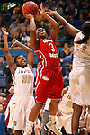 SIOUX FALLS, SD - MARCH 11:  Tempestt Wilson #3 from the University of South Dakota shoots between the defense of Demetria Nunley-Lash #31 and Shawnece Teague #23 from IUPUI in the second half of their semifinal game Monday afternoon during the Summit League Tournament in Sioux Falls, SD. (Photo by Dave Eggen/Inertia)