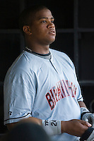 Dayan Viciedo #24 of the Birmingham Barons puts on his batting gloves as he waist for his turn to hit at Five County Stadium August 15, 2009 in Zebulon, North Carolina. (Photo by Brian Westerholt / Four Seam Images)