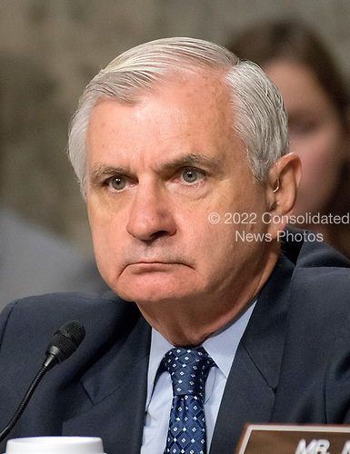 """United States Senator Jack Reed (Democrat of Rhode Island), Ranking Member, US Senate Committee on Armed Services, listens as Secretary of Defense James N. Mattis and General Joseph F. Dunford, Jr., US Marine Corps, Chairman of the Joint Chiefs of Staff, give testimony before the committee on """"the Department of Defense budget posture in review of the Defense Authorization Request for Fiscal Year 2018 and the Future Years Defense Program"""" on Capitol Hill in Washington, DC on Tuesday, June 13, 2017.<br /> Credit: Ron Sachs / CNP"""