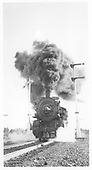 Head-on view of Southern Pacific Mikado #3317 approaching while making lots of smoke.<br /> Southern Pacific  Litchfield, AZ  Taken by Triplett, Bruce - 2/1944