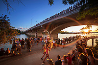Thousands of bat enthusiasts on top and below the Congress Avenue Bridge eagerly awaiting the bat show when the bats drop out of the bridge for their nightly feeding.
