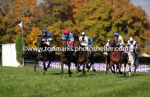 Flat Top, left, duels Tres Touche (red cap), Sur La Tete (blue and tan cap) McDynamo, right in the 2004 Breeders Cup Steepelchase at Far Hills, NJ.