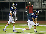 El Segundo, CA 10/30/14 - Nick Karsseboom (El Segundo #5) and Miguel Wagner-Bagues (El Segundo #3) in action during the Lawndale - El Segundo Varsity football game at El Segundo High School.  El Segundo defeated Lawndale 35-14.
