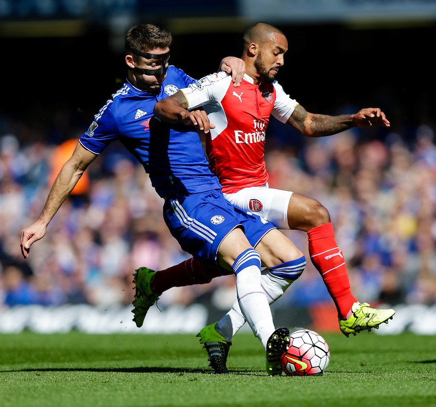 Arsenal's Theo Walcott is tackled by Chelsea's Gary Cahill<br /> <br /> Photographer Craig Mercer/CameraSport<br /> <br /> Football - Barclays Premiership - Chelsea v Arsenal - Saturday 19th September 2015 - Stamford Bridge - London<br /> <br /> &copy; CameraSport - 43 Linden Ave. Countesthorpe. Leicester. England. LE8 5PG - Tel: +44 (0) 116 277 4147 - admin@camerasport.com - www.camerasport.com