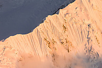 Steep fluted snowy ridge of Pioneer Peak, Denali National Park, Interior, Alaska.