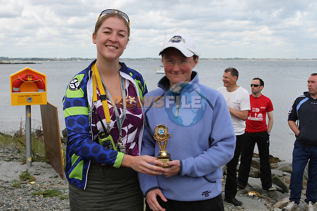 """Sue McKinney presents Alison Cardwell who came Ladies second at the Clogherhead """"Round the Head Swim""""...(Photo credit should read Jenny Matthews/NEWSFILE)..."""