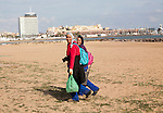 Women cleaners sandy beach sea Melilla autonomous city state Spanish territory in north Africa, Spain