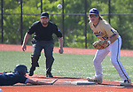 Marquette's Blake Jenkins dives safely back to first base ahead of the pick off throw to CBC first baseman Andrew Snyder. Marquette defeated CBC in the Class 5 baseball sectional played at Vianney High Schoo lin St. Louis, MO on Wednesday May 22, 2019.<br /> Tim Vizer/Special to STLhighschoolsports.com
