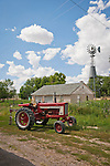 Late 1960s International 656 diesel tractor with auger and windmill, Lund, Nev.