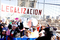 Protesters march across the Brooklyn Bridge to join thousands of others in New York City as part of the mass protest against United States immigration policy on April 10, 2006.