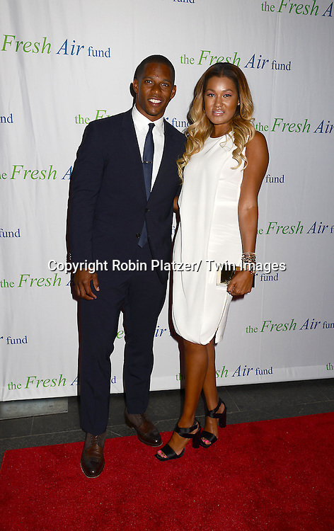 Victor Cruz and Elaine Watley attends The Fresh Air Fund Salute to Mariah Carey on May 29, 2014 at Pier Sixty at Chelsea Piers in New York, New York, USA.