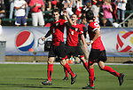 14 November 2010: Maryland's Matt Kassel (8) celebrates his goal with Taylor Kemp (2) and John Stertzer (right). The University of Maryland Terrapins defeated the University of North Carolina Tar Heels 1-0 at WakeMed Soccer Park in Cary, North Carolina in the ACC Men's Soccer Tournament Championship game.