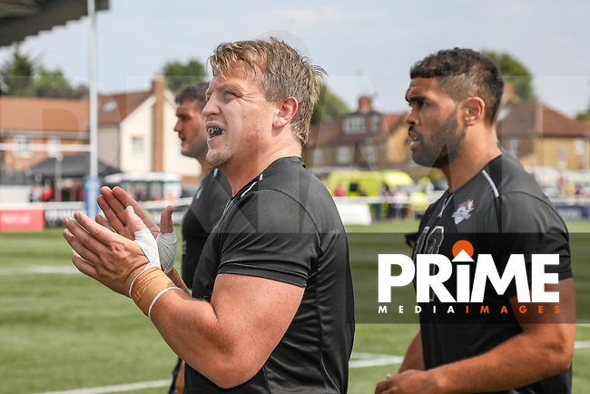Eddie BATTYE of London Broncos completes the pre much warm up ahead of the Betfred Super League match between London Broncos and Salford Red Devils at Castle Bar , West Ealing , England  on 4 August 2019. Photo by David Horn.