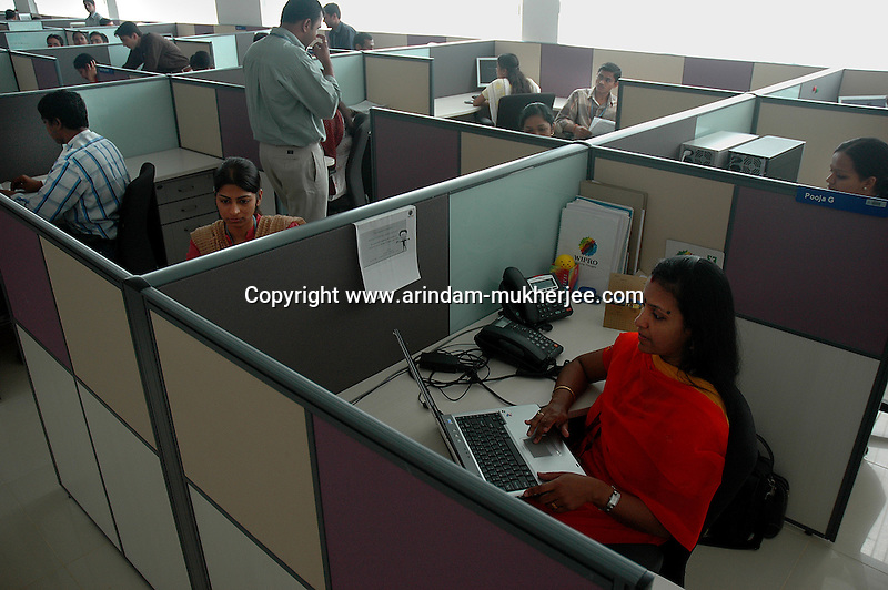 software company office. indian software professionals at work in wipro bangalore office is the second largest company t