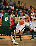 Manogue's James Sandoval drives past Alumni defender Gray Reid during the alumni game at the Wild West Shootout at Bishop Manogue High School in Reno, Nev., on Wednesday, Dec. 4, 2013. The Miners defeated the alumni 79-62. <br /> Photo by Cathleen Allison