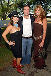 Marcy DeLuna, Chris Williams and Reese Davenport at the American Cancer Society's Cattle Baron's Ball at the George Ranch Saturday April 26,2008. (Dave Rossman/For the Chronicle)