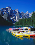 Banff National Park, Alberta, Canada:  Canoes on Moraine Lake under the towering Wenkchemna Peaks