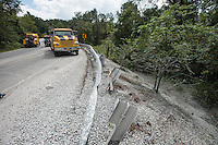 NWA Democrat-Gazette/ANTHONY REYES • @NWATONYR<br /> Gravel covers a hillside Wednesday, Sept. 9, 2015 on Highway 72 west of Tater Black Road in Centerton. An 18-wheeler, which was hauling the load of gravel, was traveling east on Highway 72 when the driver failed to properly handle and turn and rolled onto its side. Much of the load was thrown down the embankment south of the highway. There were no injuries in the accident.
