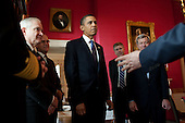 Washington, DC - October 28, 2009 -- United States President Barack Obama, U.S. Secretary of Defense Robert Gates, left, and U.S. Senator Max Baucus (Democrat of Montana), right, are briefed in the Red Room of the White House prior to the signing ceremony for the National Defense Authorization Act for Fiscal Year 2010, October 28, 2009..Mandatory Credit: Pete Souza - White House via CNP