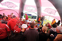 NWA Media/ J.T. Wampler - Razorback fans tailgate in a large tent Saturday Oct. 11, 2014.