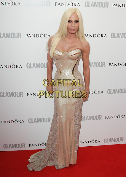 Donatella Versace.Women Of The Year 2012 - Glamour Awards, Berkeley Square, London, England..29th May 2012.full length gold strapless corset dress.CAP/ROS.©Steve Ross/Capital Pictures.