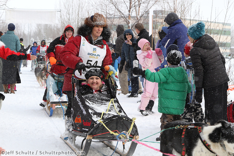 Silvia Furtwängler Mushes through Bike/ski trail in midtown Anchorage, During the 2012 Iditarod ceremonial start..Britt Coon/Iditarodphotos.com.