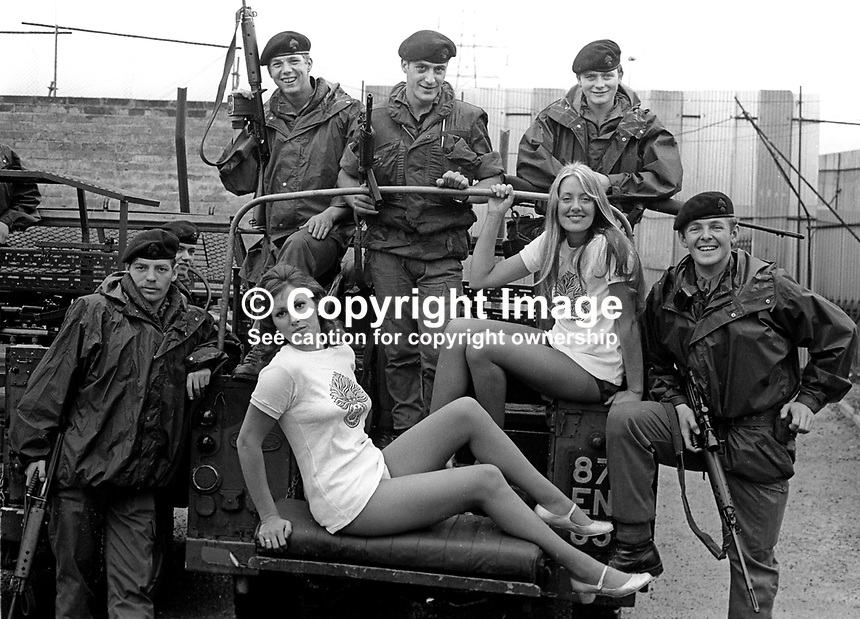 GoGo dancers from Birmingham, Mandy Moran and Maureen Rivers, in Belfast to entertain soldiers pictured with men from the Royal Regiment of Fusiliers stationed in West Belfast on peace-keeping duties. 18th September 1973. 197309180592<br />