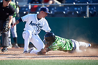 Everett AquaSox starting pitcher George Kirby (37) applies the tag to Yovanny Cuevas (17) during a Northwest League game against the Eugene Emeralds at Funko Field on August 25, 2019 in Everett, Washington. Everett defeated Eugene 6-3. (Zachary Lucy/Four Seam Images)