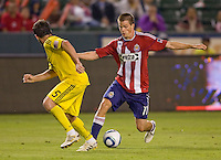 Chivas USA forward Justin Braun (17) attempts to move past Columbus Crew defender Danny O'Rourke (5). CD Chivas USA defeated the Columbus Crew 3-1 at Home Depot Center stadium in Carson, California on Saturday July 31, 2010.