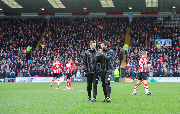 Lincoln City's assistant manager Nicky Cowley, left, and Lincoln City manager Danny Cowley prior to kick off<br /> <br /> Photographer Chris Vaughan/CameraSport<br /> <br /> The EFL Sky Bet League Two - Lincoln City v Grimsby Town - Saturday 19 January 2019 - Sincil Bank - Lincoln<br /> <br /> World Copyright &copy; 2019 CameraSport. All rights reserved. 43 Linden Ave. Countesthorpe. Leicester. England. LE8 5PG - Tel: +44 (0) 116 277 4147 - admin@camerasport.com - www.camerasport.com