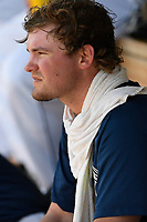 Starting pitcher Thomas McIlraith (24) of the Columbia Fireflies waits in the dugout during a game against the Rome Braves on Sunday, July 2, 2017, at Spirit Communications Park in Columbia, South Carolina. Columbia won, 3-2, as McIlraith threw siz no-hit innings. (Tom Priddy/Four Seam Images)