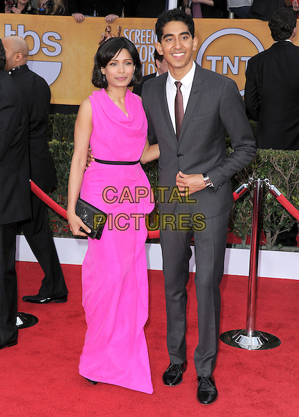 Freida Pinto (wearing Roland Mouret) & Dev Patel .Arrivals at the 19th Annual Screen Actors Guild Awards at the Shrine Auditorium in Los Angeles, California, USA..27th January 2013.SAG SAGs full length pink dress grey gray suit couple black clutch bag draped.CAP/DVS.©DVS/Capital Pictures.