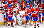 10 April 2010: Montreal Canadiens' goaltender Jaroslav Halak is consoled by teammates after the last game of the regular season against the Toronto Maple Leafs at the Bell Centre in Montreal, Quebec, Canada. The Leafs defeated the Habs 4-3 in sudden death overtime as the Canadiens advance to the Stanley Cup Playoffs with the single point. Mandatory Credit: Ed Wolfstein Photo