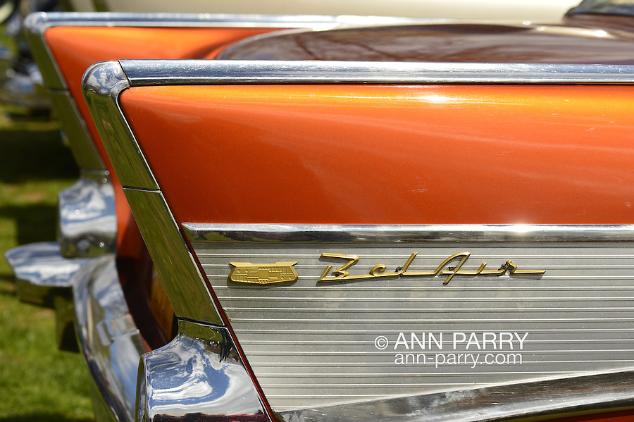Floral Park, New York, U.S. - April 27, 2014 - An orange 1957 Chevrolet Bel Air, with a ribbed aluminum inset in its tail fin, is exhibited by members of the New York Antique Auto Club at the 35th Annual Antique Auto Show at Queens Farm.