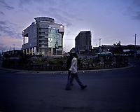 Two men walk in front of The Ministry of Sicence building in Ethiopia's capital Addis Ababa on Wednesday October 28, 2009.