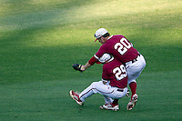 Indiana Hoosiers outfielder Casey Smith (20) makes a running catch as second baseman Chad Clark (29) runs into him during Game 9 of the 2013 Men's College World Series against the Oregon State Beavers on June 19, 2013 at TD Ameritrade Park in Omaha, Nebraska. The Beavers defeated the Hoosiers 1-0, eliminating Indiana from the tournament. (Andrew Woolley/Four Seam Images)