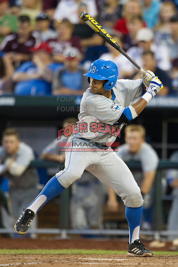 UCLA designated hitter Kevin Williams (5) at bat during Game 1 of the 2013 Men's College World Series Finals against the Mississippi State Bulldogs on June 24, 2013 at TD Ameritrade Park in Omaha, Nebraska. The Bruins defeated the Bulldogs 3-1, taking a 1-0 lead in the best of 3 series. (Andrew Woolley/Four Seam Images)