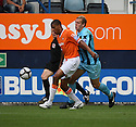 Shane Blackett of Luton holds off Danny Wright of Cambridge United during the Blue Square Bet Premier match between Luton Town and Cambridge United at Kenilworth Road, Luton  on 11th September 2010.© Kevin Coleman 2010