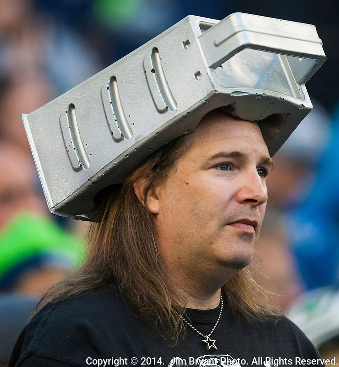 A Seattle Seahawks fan wears a cheese grader while watching  the Green Bay Packers in the  NFL Kickoff Game game at CenturyLink Field in Seattle, Washington on September 4, 2014.  Seattle beat Green Bay 36-16. ©2014  Jim Bryant Photo. ALL RIGHTS RESERVED.