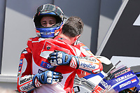 Ducati's Team rider Italian Andrea Dovizioso (C), winner, Movistar Yamaha's Spanish rider Maverick Vinales (L), second, and OCTO Pramac Yakhnich's Italian rider Danilo Petrucci, third, celebrate on the podium after winning the Moto GP Grand Prix at the Mugello race track on June 4, 2017. Ducati's Andrea Dovizioso thrilled the home crowds with a stirring MotoGP victory at Mugello on Sunday that saw him edge championship leader Maverick Vinales. Another Italian, Danilo Petrucci, was third while veteran superstar Valentino Rossi of Yamaha won plaudits for racing in pain from a training accident and finishing fourth having set the early pace.<br /> Photo by Danilo D'Auria.<br /> <br /> Danilo D'Auria/UK Sports Pics Ltd/Alterphotos /NortePhoto.com